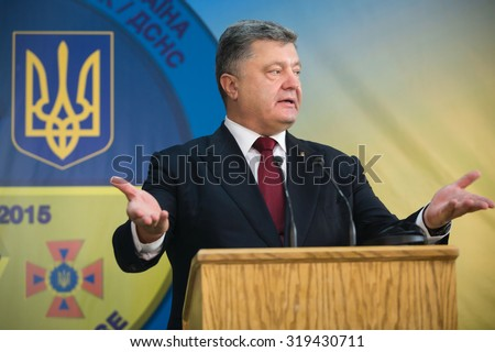 "LVIV, UKRAINE - Sep 21, 2015: President of Ukraine Petro Poroshenko and NATO Secretary General Jens Stoltenberg during a visit to the teachings of the Ukraine-NATO disaster relief ""Ukraine-2015"" - stock photo"