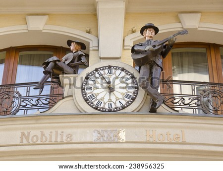 LVIV, UKRAINE - SEPTEMBER 16: figurines outside Nobilis Hotel on September 16, 2014 in Lviv, Ukraine. Nobilis Hotel is a Five Star luxury hotel in Lviv.  - stock photo