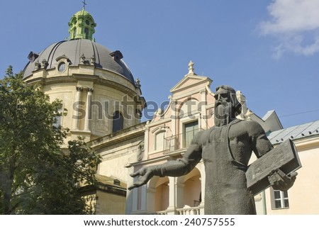 LVIV, UKRAINE - SEPTEMBER 16: statue of Ivan Fedorov in front of church on September 16, 2014 in Lviv, Ukraine. Ivan Fedorov (1525-1583) was the first printer in Russia and Ukraine. - stock photo