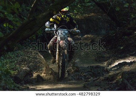 Lviv, Ukraine - 11 Septemberl 2016: The third stage of the Ukrainian championship in cross-country cycling . Unknown  racer overcomes the track in the forest