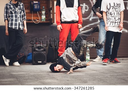 LVOV, UKRAINE - JULY 17, 2015: a brelle boy ittak dancer dancing on the street - stock photo