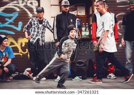 LVOV, UKRAINE - JULY 17, 2015: a little boy break dancer dancing on the street - stock photo