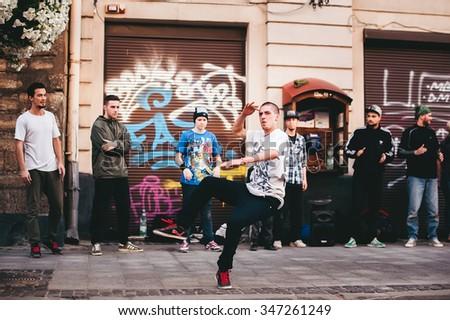 LVOV, UKRAINE - JULY 17, 2015: break dancer dancing on the street - stock photo