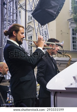 Lvov, Ukraine - 25 June 2015: Alfa Jazz Fest 2015. The trumpeter and saxophonist performs at a concert with Antony Strong on stage jazz festival on the Market Square in Lvov near the town hall. - stock photo
