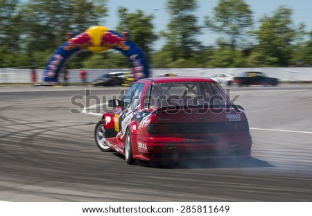 Lvov, Ukraine - June 6, 2015: Unknown rider on the car brand Nissan overcomes the track in the championship of Ukraine drifting in Lvov, Ukraine. - stock photo