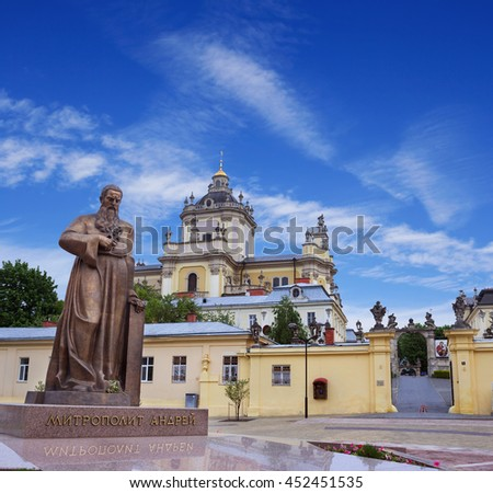 LVOV, UKRAINE - MAY 8, 2016:  Entrance to one of the most popular churches in Lviv - St. George's Cathedral and a newly erected monument of metropolitan Andrey Sheptytsky