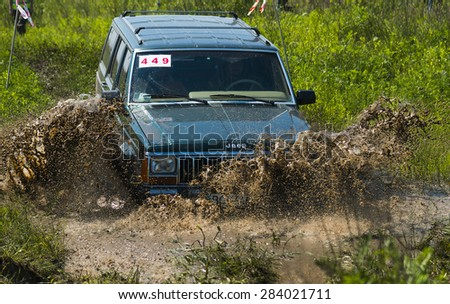 Lvov, Ukraine - May 30, 2015: Off-road vehicle Jeep Cherokee (No 449) overcomes the track on of landfill near the city Lvov, Ukraine. - stock photo