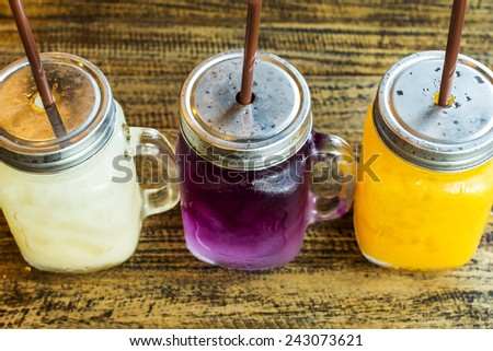 Lychee juice, Blue pea with limeand honey, Orange juice. - stock photo