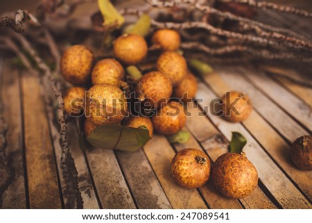 lychee - Litchi chinensis closeup on brown board background - stock photo