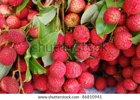 Lychee on market stand - stock photo