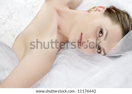 lying beauty bride in white dress - stock photo