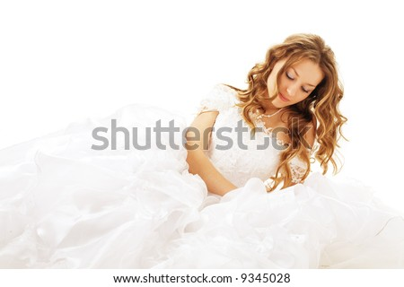 lying beauty bride in white dress isolated - stock photo