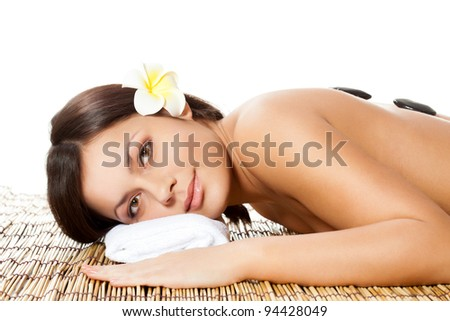 lying brunette woman receiving massage of head - stock photo