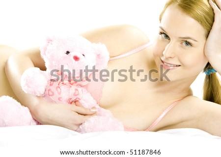 lying down woman wearing underwear with teddy bear - stock photo