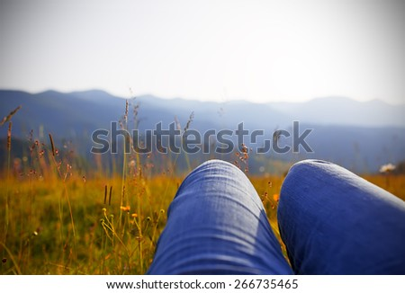 Lying in aromatic mountain meadow. - stock photo