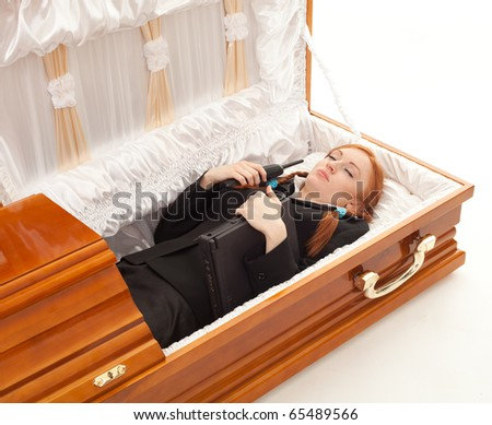 lying in coffin young woman with laptop and phone
