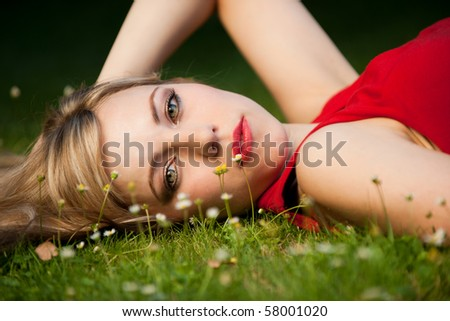 lying in the grass - stock photo