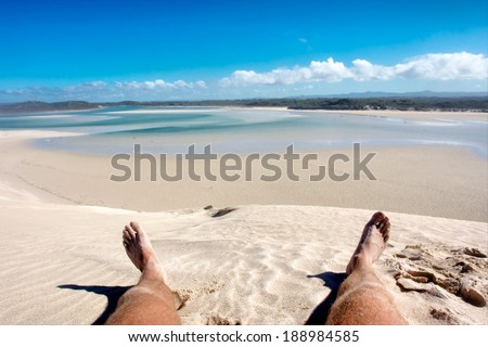 Lying on beach - legs in sand. Shot in the Die Mond nature reserve near Cape Town, Whale Coast, Western Cape, South Africa. - stock photo