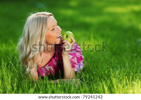 lying on green grass - stock photo