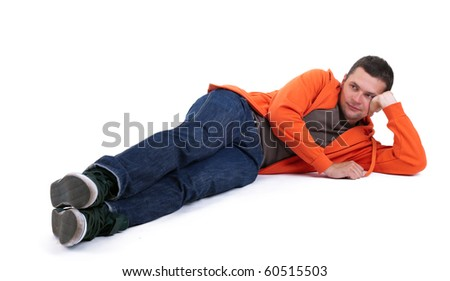 lying on the floor man in orange sweatshirt with head on palm - stock photo