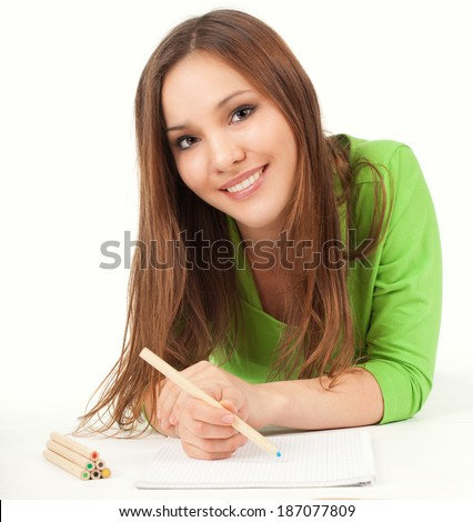 lying on the floor young woman drawing, white background - stock photo