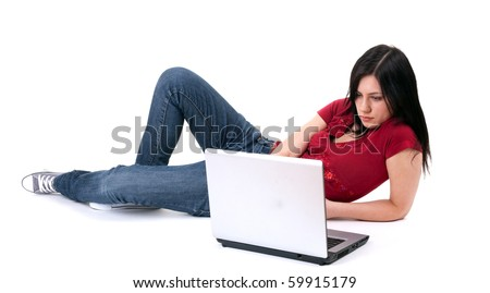 lying on the floor young woman working on laptop