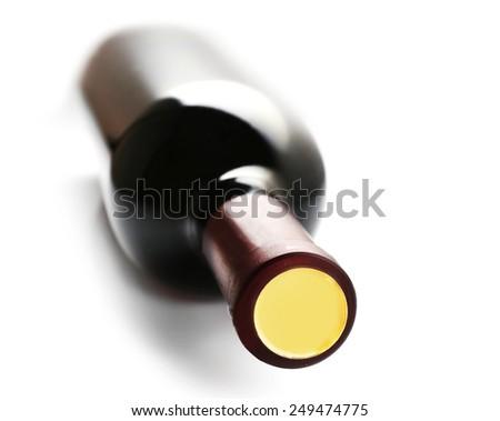 Lying red wine bottle, isolated on white - stock photo