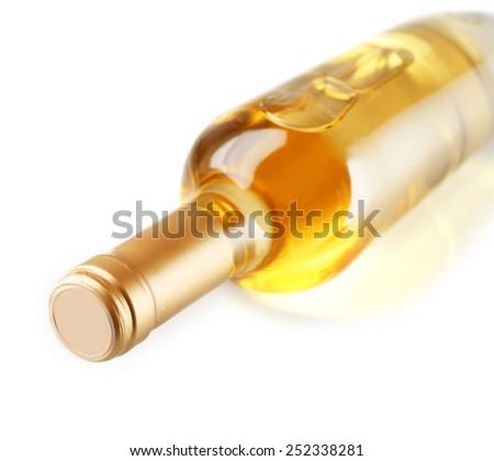 Lying wine bottle, isolated on white - stock photo