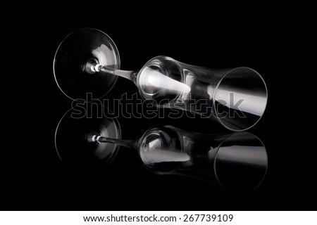 lying wine glass on black - stock photo