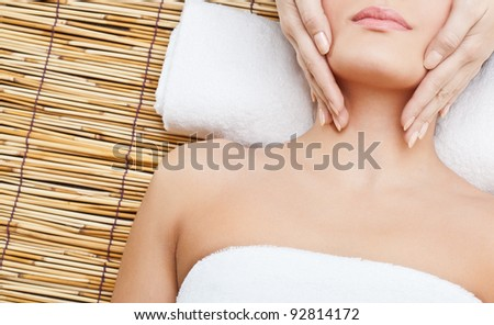 lying woman massaging her neck - stock photo