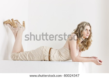 lying woman wearing summer clothes and shoes - stock photo