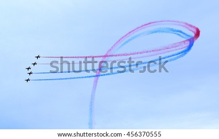 LYME REGIS, UNITED KINGDOM-JULY 21, 2016:The Royal Air Force Red Arrows Display Team perform  in Lyme Regis, Dorset - stock photo