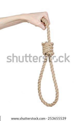 Lynching and suicide theme: man's hand holding a loop of rope for hanging on white isolated background - stock photo