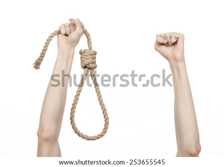 Lynching and suicide theme: man's hand holding a loop of rope for hanging on white isolated background