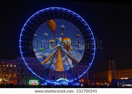 LYON, FRANCE, December 8, 2016 : Show on the big wheel of Bellecour. The Festival of Lights expresses gratitude toward Mother Mary around December 8th with different light shows each year.