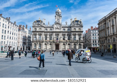 LYON, FRANCE - MARCH 20: people walk in Place des Terreaux in Lyon on March 20, 2014. The Historic Site of Lyon was designated a UNESCO World Heritage Site in 1998. - stock photo