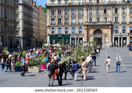 LYON, FRANCE: MAY 29, 2015 - Rose Festival (Festival des Roses) in Lyon, France. View on square des Terreaux and its flower compositions.  - stock photo