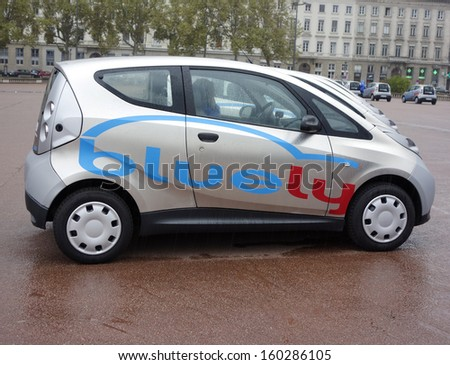 LYON, FRANCE - OCTOBER 10: Bluely electrical car in Lyon on October 10, 2013. Bluely is the first full electric and open-access car sharing service in Lyon introduced to public in October 2013. - stock photo