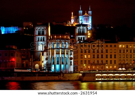 Lyon is turned into a live public art show with its annual festival of light at December 8th.. With its principal buildings in the spotlight,  the Fourviere Hill is revealed. - stock photo