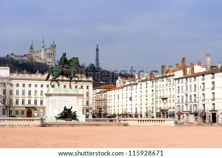 Lyon Main square with Statue of Louis and Basilique Fourviere on a background, France - stock photo
