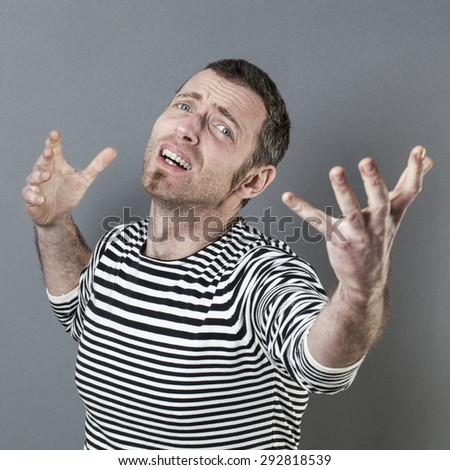 lyrical 40's man pleading for something with determination and passion with hands onwards and backwards with an anxious comedian expression - stock photo