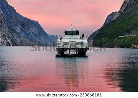 LYSEBOTN, NORWAY - SEPT 23: Ferry arriving in Lysebotn, after trip on the Lysefjord  on Sept 23, 2014, Norway  - stock photo