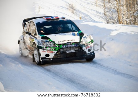 LYSVIK, SWEDEN - FEB 11: Mads Ostberg driving his Ford on Special Stag 5 at the event Rally Sweden 2011 in Lysvik, Sweden on Feb 11, 2011 - stock photo