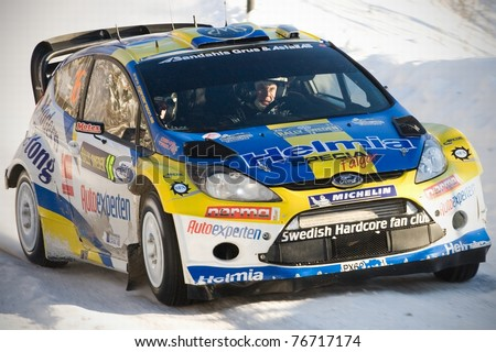 LYSVIK, SWEDEN - FEB 11: PG Andersson driving his Ford Fiesta WRC during the WRC event Rally Sweden 2011 in Lysvik , Sweden on Feb 11, 2011 - stock photo