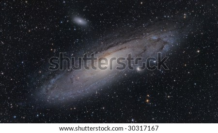 M31 Andromeda Galaxy, and it's satellites M32 and M110 small elliptical galaxies. - stock photo
