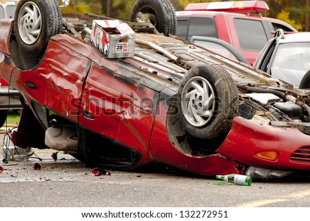 M'CHIGEENG, ONTARIO, CANADA-OCTOBER 1: Mock  car accident scene coordinated by police, fire, ambulance, and victim services, to educate students on the dangers of impaired driving, on October 1, 2008. M'Chigeeng, Ontario - stock photo