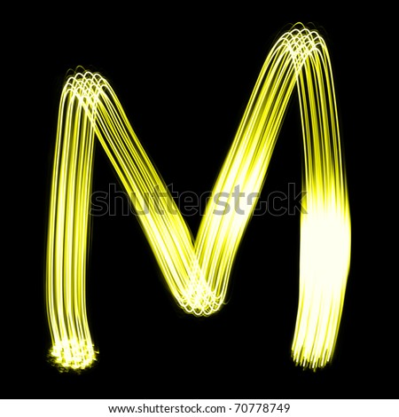 M - Created by light alphabet over black background - stock photo