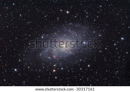 M33 Galaxy between Triangulum and Andromeda constellations - stock photo