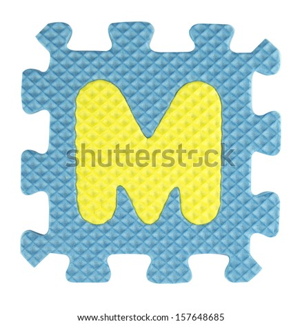 M letter, Alphabet puzzle isolated on white background , with clipping path. - stock photo