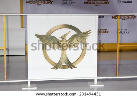 m LOS ANGELES - NOV 17:  Mockingjay Emblem at the The Hunger Games: Mockingjay Part 1 Premiere at the Nokia Theater on November 17, 2014 in Los Angeles, CA - stock photo